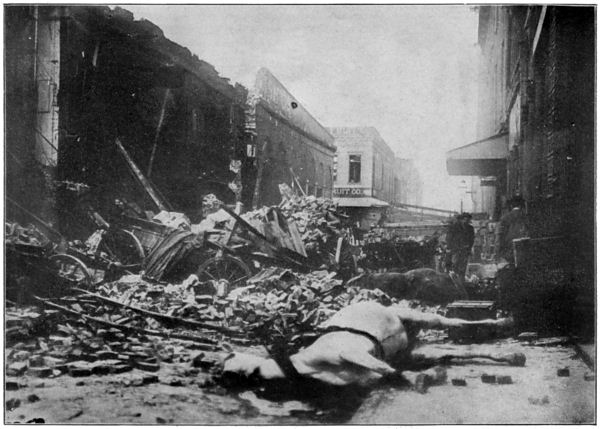 A Photograph of the Devastation in the Wholesale District. A Horse Lies Dead in the Middle of the Street, Surrounded by Rubble