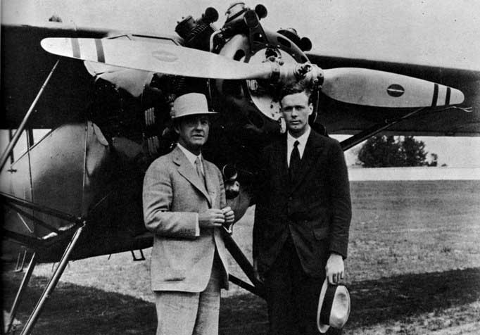 "Alvan Macauley (left), President of the Packard Motor Car Co. and Col. Charles A. Lindbergh with the original Packard diesel-powered Stinson ""Detroiter"" in the background, 1929"