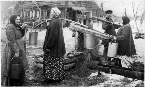 Russian peasants in pre-Revolution Russia draw water from a well.